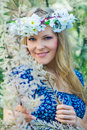 Beautiful young womanin a wreath with a flowers over face Royalty Free Stock Images