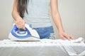 Beautiful young women ironing a shirt Royalty Free Stock Photo