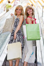 Beautiful young women shopping. Royalty Free Stock Photo