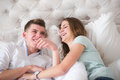 A beautiful younge couple in bed are having fun photo of Royalty Free Stock Photos