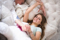 A beautiful younge couple in bed are having fun photo of Royalty Free Stock Photo