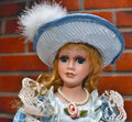 Beautifull dol doll with blue hat Royalty Free Stock Image