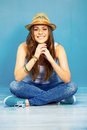 Beautifull woman sitting on a floor Royalty Free Stock Photo