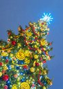 Beautifully decorated Christmas tree against the background of the night sky Royalty Free Stock Photo