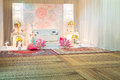 A beautifully english theme decorated wedding altar on a stage a at function Stock Image