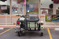 A beautifully maintained motorcycle bike with sidecar as seen parked at strip mall in moab Royalty Free Stock Photo