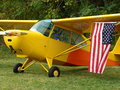 Beautifully restored classic Aeronca 7AC Champ Displaying US flag. Royalty Free Stock Photo