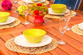 Beautifully set table in bright colors Royalty Free Stock Photos