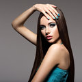 Beautiul elegant woman with turquoise make up and nails straigh pose at studio Stock Images