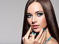 Beautiul elegant woman with turquoise make up and nails straigh pose at studio Stock Image