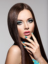 Beautiul elegant woman with turquoise make up and nails straigh pose at studio Royalty Free Stock Photo