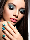 Beautiul fashion woman with turquoise make up and nails on white background Royalty Free Stock Images