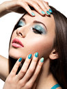 Beautiul fashion woman with turquoise make up and nails on white background Stock Image