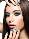 Beautiul fashion woman with turquoise make up and nails on white background Royalty Free Stock Photography