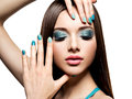Beautiul fashion woman with turquoise make up and nails on white background Royalty Free Stock Photos