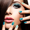 Beautiul fashion young adult girl with turquoise make up and nai nails Stock Image