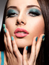 Beautiul fashion young adult girl with turquoise make up and nai nails Royalty Free Stock Photography