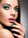 Beautiul fashion young adult girl with turquoise make up and nai nails Stock Photos