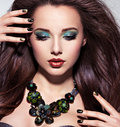 Beautiul woman with long brown hairs turquoise make up and na nails Stock Image
