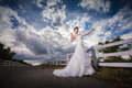 Beautuful bride in forest cloudy twilight blue sky Royalty Free Stock Photography