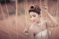 Beautuful bride in forest cloudy twilight blue sky head and shoulder close up shot Royalty Free Stock Photo