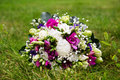 Beautuful wedding bouquet beautiful bridal of flowers on green lawn Stock Images