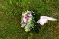 Beautuful wedding bouquet beautiful bridal of flowers on green lawn Stock Photo