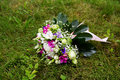 Beautuful wedding bouquet beautiful bridal of flowers on green lawn Royalty Free Stock Image