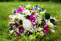 Beautuful wedding bouquet beautiful bridal of flowers on green lawn Royalty Free Stock Photography