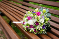 Beautuful wedding bouquet beautiful bridal of flowers on wooden bench Royalty Free Stock Photos