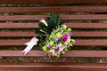 Beautuful wedding bouquet beautiful bridal of flowers on wooden bench Stock Photography