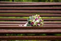 Beautuful wedding bouquet beautiful bridal of flowers on wooden bench Stock Images