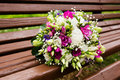Beautuful wedding bouquet beautiful bridal of flowers on wooden bench Royalty Free Stock Photo