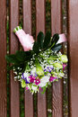 Beautuful wedding bouquet beautiful bridal of flowers on wooden bench Stock Photo