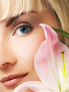 Beautuful woman with pink lily Royalty Free Stock Photography