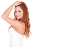 Beautuful woman with red long hair posing in white dress isolated on Royalty Free Stock Photos