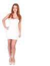 Beautuful woman with red long hair posing in white dress isolated on Stock Photography