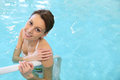 Beautuful young woman in a bathing suit bathing portrait of beautiful swimming pool Royalty Free Stock Image