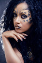Beauty afro girl with cat make up creative leopard print closeup Royalty Free Stock Image