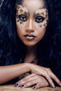 Beauty afro girl with cat make up creative leopard print closeup halloween Royalty Free Stock Photo