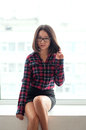 Beauty asian girl sitting on windowsill with glasses in skirt Stock Images