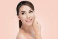 Beauty Asian Portrait. Beautiful Spa Asian Woman Touching her Face. Perfect Fresh Skin Royalty Free Stock Photo
