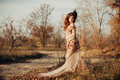 Beauty autumn woman in dress with leaves Royalty Free Stock Photo