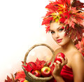 Beauty autumn woman with ripe red organic apples Royalty Free Stock Images