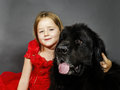 Beauty and the Beast. Girl with big black water-dog. Royalty Free Stock Photo