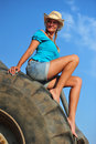 Beauty beautiful woman with blond curls posing on a digger Stock Images
