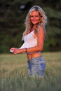 Beauty beautiful woman with blond curls posing on a meadow Stock Images