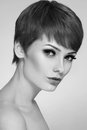 Beauty black and white portrait of young beautiful woman with stylish short haircut and extended lashes Stock Photos