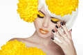 Beauty Blond Female Portrait with yellow flowers. Beautiful Spa Royalty Free Stock Photos