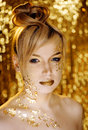 Beauty blond woman with gold creative make up close Royalty Free Stock Image